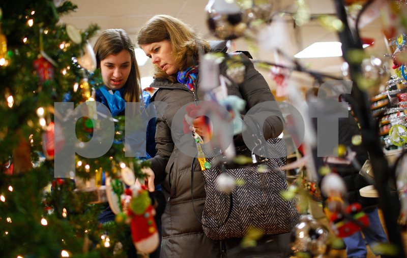 Kyle Bursaw – kbursaw@shawmedia.com<br /> <br /> Mary Stang (left) browses ornaments for sale with her mother Lisa (center) at Sweet Earth in Sycamore, Ill. on Tuesday, Dec. 18, 2012.