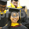 Rob Winner – rwinner@shawmedia.com<br /> <br /> Margaret Abellera smiles while lining up before Saturday's graduate school commencement ceremony inside the Convocation Center at Northern Illinois University in DeKalb.<br /> <br /> Saturday, Dec. 15, 2012