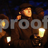 Kyle Bursaw – kbursaw@shawmedia.com<br /> <br /> DeKalb County Clerk John Acardo holds a candle during a vigil at Memorial Park in DeKalb, Ill. on Friday, Dec. 21, 2012. The vigil was for those who died in the Newton, Conn. shooting last Friday.