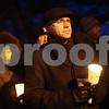 Kyle Bursaw – kbursaw@shawmedia.com<br /> <br /> DeKalb County Clerk John Acardo holds a candle during a vigil at Memorial Park in DeKalb, Ill. on Friday, Dec. 21, 2012. The vigil was for those who died in the Newton, Conn. shooting last Friday.