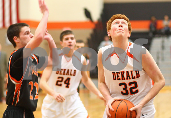 Kyle Bursaw – kbursaw@shawmedia.com<br /> <br /> DeKalb forward Micah Fagerstrom  plants his feet for a shot  while defended by Winnebago guard Taylor Shumate in the first quarter of their game in the Chuck Dayton Holiday Tournament in DeKalb, Ill. on Friday, Dec. 21, 2012.