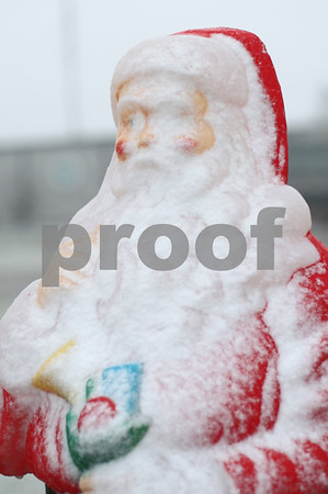 Kyle Bursaw – kbursaw@shawmedia.com<br /> <br /> A Santa statue sitting outside the DeKalb County Highway Department accumulates snow on Thursday, Dec. 20, 2012.