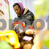 Kyle Bursaw – kbursaw@shawmedia.com<br /> <br /> Shataja Johnson, of DeKalb, browses a table of toys to find one for her six-year-old daughter during the Salvation Army's toy and clothing distribution on Tuesday, Dec. 18, 2012.