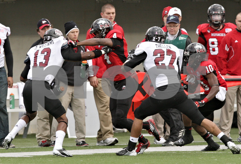 Rob Winner – rwinner@shawmedia.com<br /> <br /> After a reception, Northern Illinois receiver Tommylee Lewis (10) follows teammate Da'Ron Brown (4) as Brown blocks Massachusetts defensive back D'Metrius Williams (13) during the first quarter of their game in DeKalb, Ill., Saturday, Nov. 3, 2012.