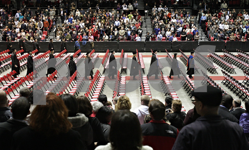 Rob Winner – rwinner@shawmedia.com<br /> <br /> Northern Illinois University graduates begin entering the Convocation Center in DeKalb as commencement begins on Saturday afternoon.<br /> <br /> Saturday, Dec. 15, 2012