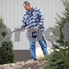 Kyle Bursaw – kbursaw@shawmedia.com<br /> <br /> Blumen Gardens co-owner Joel Barczak waters evergreens at a private home in Sycamore, Ill. on Monday, Dec. 17, 2012.