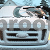 Kyle Bursaw – kbursaw@shawmedia.com<br /> <br /> Sycamore resident Justin Yahnig clears the snow beneath one of his windshield wipers in a parking lot at the corner of West Elm Street and Somonauk Street on Thursday, Dec. 20, 2012.