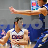 Kyle Bursaw – kbursaw@shawmedia.com<br /> <br /> Genoa-Kingston's Sal Lopez passes underneath a Burlington Central player. Burlington Central defeated Genoa-Kingston 64-41 in Genoa, Ill. on Tuesday, Dec. 18, 2012.