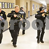 "Rob Winner – rwinner@shawmedia.com<br /> <br /> Kirkland police officers including Sgt. Paul Lindstrom (from left to right), Alton E. Parker, Jr., Travis Coburn, and Tony Miller maneuver around the corner of a hallway while participating in a Rapid Response training drill at Hiawatha Elementary School in Kirkland, Ill., Saturday, Dec. 15, 2012. Eight members of the Kirkland Police Department participated in the drills which began at 8 a.m. and concluded at 4 p.m. Training instructor Joe Drought, Chief at the Rock Valley College Police Department, said the one-day course is designed to ""teach officers to make an immediate response to an active shooter or ongoing threats to human life."" <br /> <br /> ***Coburn has his back turned.***"