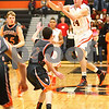 Kyle Bursaw – kbursaw@shawmedia.com<br /> <br /> DeKalb guard Zach Ottum passes midair in the first quarter of the game against Winnebago in the Chuck Dayton Holiday Tournament in DeKalb, Ill. on Friday, Dec. 21, 2012.