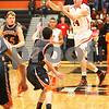 Kyle Bursaw – kbursaw@shawmedia.com<br /> <br /> DeKalb guard Zach Ottum passes midair in the first quarter of the game against Winnebago in the Chuck Dayton Holiday Tournament in DeKalb, Ill. on Friday, Dec. 21, 2012.