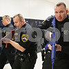"""Rob Winner – rwinner@shawmedia.com<br /> <br /> Kirkland police officers including Alton E. Parker, Jr. (from left to right), Nevres Gibic, and Edward Muchala participate in a Rapid Response training drill at Hiawatha Elementary School in Kirkland, Ill., Saturday, Dec. 15, 2012. Eight members of the Kirkland Police Department participated in the drills which began at 8 a.m. and concluded at 4 p.m. Training instructor Joe Drought, Chief at the Rock Valley College Police Department, said the one-day course is designed to """"teach officers to make an immediate response to an active shooter or ongoing threats to human life."""""""