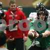 Kyle Bursaw – kbursaw@shawmedia.com<br /> <br /> Northern Illinois quarterback Jordan Lynch (6) holds out the ball for wide receiver Tommylee Lewis (10) <br /> at practice at the DeKalb Recreation Center on Wednesday, Dec. 19, 2012.