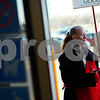 Kyle Bursaw – kbursaw@shawmedia.com<br /> <br /> Salvation Army bell ringer Dora Virginia May Utter Rodriguez draws attention to the donation kettle while wishing shoppers a Merry Christmas outside Walmart on Thursday, Dec. 13, 2012.