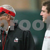Kyle Bursaw – kbursaw@shawmedia.com<br /> <br /> Northern Illinois University tight end and fullback coach Mike Sabock watches the players at practice at the DeKalb Recreation Center on Wednesday, Dec. 19, 2012.