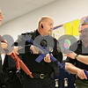 """Rob Winner – rwinner@shawmedia.com<br /> <br /> Rapid Response instructors Todd Houde (left) and Joe Drought (right) help train Stan Smith, Chief of the Kirkland Police Department, during a drill at Hiawatha Elementary School in Kirkland, Ill., Saturday, Dec. 15, 2012. Eight members of the Kirkland Police Department participated in the drills which began at 8 a.m. and concluded at 4 p.m. Drought, Chief at the Rock Valley College Police Department, said the one-day course is designed to """"teach officers to make an immediate response to an active shooter or ongoing threats to human life."""""""