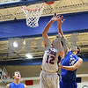 Kyle Bursaw – kbursaw@shawmedia.com<br /> <br /> Genoa-Kingston's Adam Price puts up a shot in front of Burlington Central's Duncan Ozburn in the first quarter. Burlington Central defeated Genoa-Kingston 64-41 in Genoa, Ill. on Tuesday, Dec. 18, 2012.