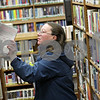 Rob Winner – rwinner@shawmedia.com<br /> <br /> DeKalb resident Debbie Thompson looks over fiction books at the DeKalb Public Library on Wednesday, Dec. 26, 2012. Thompson visits the library at least once a week.
