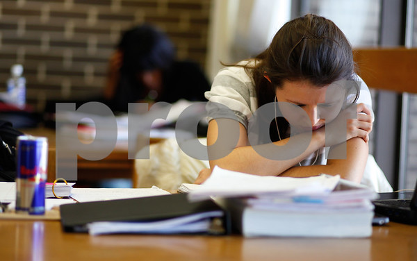 Kyle Bursaw – kbursaw@shawmedia.com<br /> <br /> Jackie Smith, a junior at NIU, leans in closer to her work while studying for finals at the Founders Memorial Library in DeKalb, Ill. on Thursday, Dec. 13, 2012.