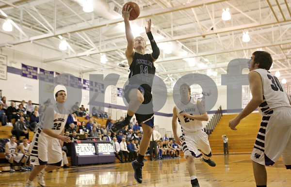 Rob Winner – rwinner@shawmedia.com<br /> <br /> Hinckley-Big Rock's Michael Bayler (14) puts up two early in the first quarter at the Plano Holiday Classic in Plano, Ill., Wednesday, Dec. 26, 2012. H-BR defeated Wilmington, 88-64.