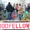 Kyle Bursaw – kbursaw@shawmedia.com<br /> <br /> Goodfellows volunteers carry gift bags out of Blumen Gardens to load up and deliver to various families in the area on Monday, Dec. 24, 2012.