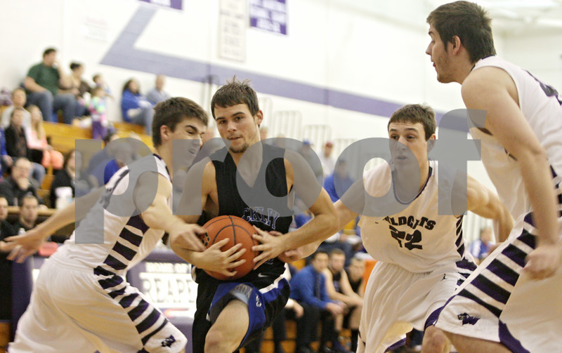 Rob Winner – rwinner@shawmedia.com<br /> <br /> Hinckley-Big Rock's Bernie Conley (second from left) goes to the basket in the first quarter at the Plano Holiday Classic in Plano, Ill., Wednesday, Dec. 26, 2012. H-BR defeated Wilmington, 88-64.