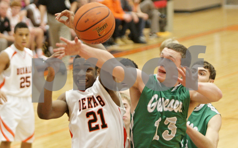 Rob Winner – rwinner@shawmedia.com<br /> <br /> DeKalb's Riccardo Pitts (21) and Geneseo's Luke Snyder (13) try to control a rebound under the Barbs' basket in the first quarter at the Chuck Dayton Tournament in DeKalb, Ill., Friday, Dec. 28, 2012. DeKalb defeated Geneseo, 60-55.