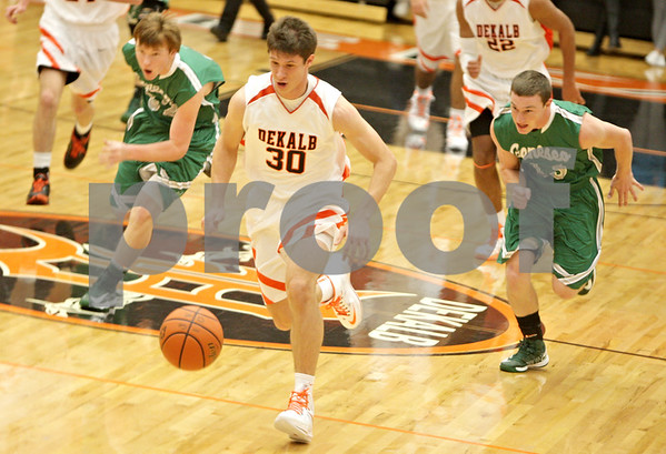 Rob Winner – rwinner@shawmedia.com<br /> <br /> DeKalb's Jake Carpenter forces a turnover in the first quarter at the Chuck Dayton Tournament in DeKalb, Ill., Friday, Dec. 28, 2012. DeKalb defeated Geneseo, 60-55.
