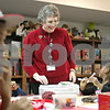 Rob Winner – rwinner@shawmedia.com<br /> <br /> Youth services manager Theresa Winterbauer helps a group of children with a craft project at the DeKalb Public Library on Wednesday, Dec. 26, 2012.