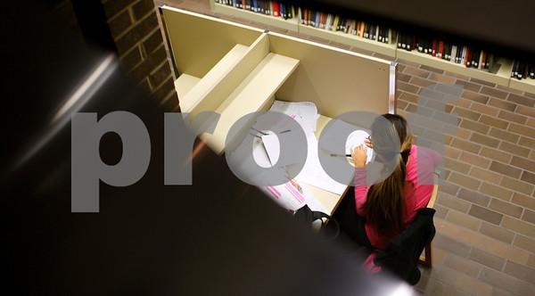 Kyle Bursaw – kbursaw@shawmedia.com<br /> <br /> Cindy Garcia, a junior at NIU, prepares for her English 207 final at Founders Memorial Library in DeKalb, Ill. on Thursday, Dec. 13, 2012.