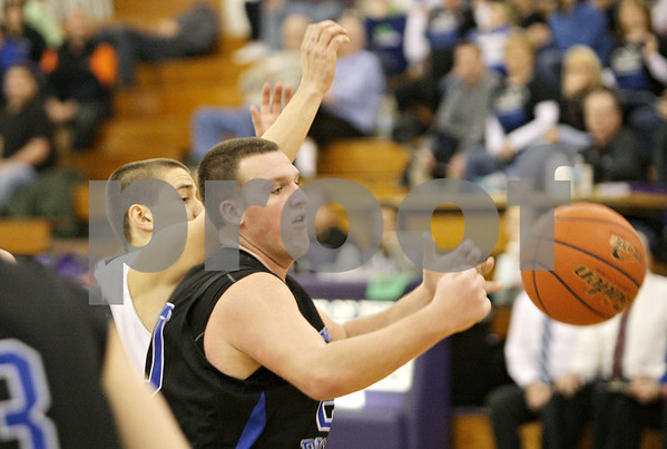 Rob Winner – rwinner@shawmedia.com<br /> <br /> Hinckley-Big Rock's Zack Michels chases after a ball in the fourth at the Plano Holiday Classic in Plano, Ill., Wednesday, Dec. 26, 2012. H-BR defeated Wilmington, 88-64.