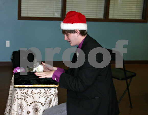 Jeff Engelhardt – jengelhardt@shawmedia.com<br /> Kyler Yeomans grabs his dove Bartholomew after making it appear simultaneously with a balloon pop during his magic show at Hope Haven Tuesday.