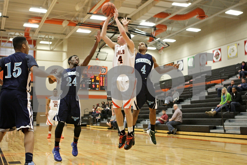 Rob Winner – rwinner@shawmedia.com<br /> <br /> DeKalb's Zach Ottum (4) puts up a shot good for two points in the second quarter at the Chuck Dayton Holiday Tournament in DeKalb, Ill., Thursday, Dec. 27, 2012. Thornridge defeated DeKalb, 64-66.