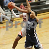 Rob Winner – rwinner@shawmedia.com<br /> <br /> DeKalb's Andre Harris (22) is fouled on his way to the basket in the fourth quarter at the Chuck Dayton Holiday Tournament in DeKalb, Ill., Thursday, Dec. 27, 2012. Thornridge defeated DeKalb, 64-66.