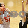 Rob Winner – rwinner@shawmedia.com<br /> <br /> DeKalb's Rachel Torres puts up two with a shot during the third quarter in DeKalb, Ill., Tuesday, Dec. 11, 2012. DeKalb defeated Kaneland, 31-17.