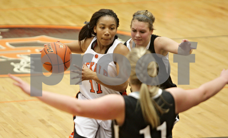 Rob Winner – rwinner@shawmedia.com<br /> <br /> DeKalb's Courtney Patrick (11) drives to the basket during the fourth quarter in DeKalb, Ill., Tuesday, Dec. 11, 2012. DeKalb defeated Kaneland, 31-17.