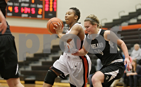 Rob Winner – rwinner@shawmedia.com<br /> <br /> DeKalb's Courtney Patrick (11) looks to pass as Kaneland's Allyson O'Herron (30) defends during the first quarter in DeKalb, Ill., Tuesday, Dec. 11, 2012. DeKalb defeated Kaneland, 31-17.