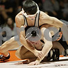 Rob Winner – rwinner@shawmedia.com<br /> <br /> Kaneland's Sonny Horn (top) controls DeKalb's Brad Green during their 138-pound match in DeKalb, Ill., Thursday, Dec. 6, 2012. DeKalb defeated Kaneland, 50-23.