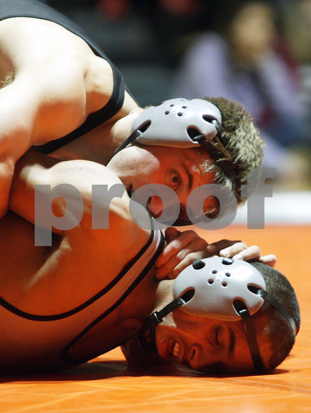 Rob Winner – rwinner@shawmedia.com<br /> <br /> DeKalb's Doug Johnson (top) controls Kaneland's Esai Ponce during their 132-pound match in DeKalb, Ill., Thursday, Dec. 6, 2012. DeKalb defeated Kaneland, 50-23.