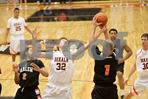 Rob Winner – rwinner@shawmedia.com<br /> <br /> DeKalb's Micah Fagerstrom (32) and Harlem's Justin Vanwambeke go up for a rebound under the Barbs' basket in the second quarter at the Chuck Dayton Holiday Tournament in DeKalb, Ill., Saturday, Dec. 22, 2012.