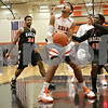 Rob Winner – rwinner@shawmedia.com<br /> <br /> DeKalb's Andre Harris (center) looks to the basket before putting up a shot good for two in the first quarter against Harlem at the Chuck Dayton Holiday Tournament in DeKalb, Ill., Saturday, Dec. 22, 2012.