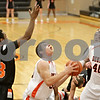 Rob Winner – rwinner@shawmedia.com<br /> <br /> DeKalb's Jake Carpenter looks to shoot in the first quarter against Harlem at the Chuck Dayton Holiday Tournament in DeKalb, Ill., Saturday, Dec. 22, 2012.