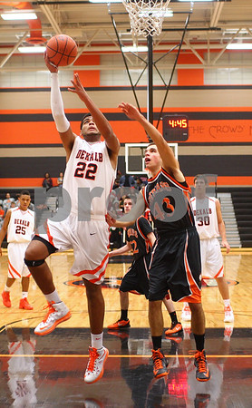 Kyle Bursaw – kbursaw@shawmedia.com<br /> <br /> DeKalb's Andre Harris puts up a shot  while being defended by Winnebago forward Joey Morrissey in the first quarter of their game in the Chuck Dayton Holiday Tournament in DeKalb, Ill. on Friday, Dec. 21, 2012.