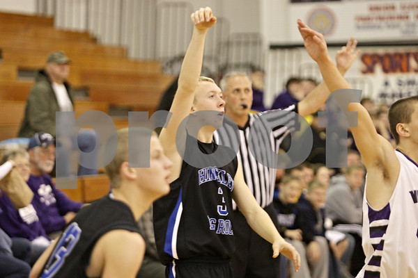 Rob Winner – rwinner@shawmedia.com<br /> <br /> Hinckley-Big Rock's Jared Madden (3) watches the ball as he successfully shoots a field goal in the fourth quarter at the Plano Holiday Classic in Plano, Ill., Wednesday, Dec. 26, 2012. H-BR defeated Wilmington, 88-64.