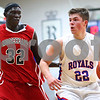 Kyle Bursaw – kbursaw@shawmedia.com<br /> <br /> Hinckley-Big Rock's Mitch Ruh takes the ball up the court while being defended by Mooseheart's Makur Puou. Hinckley-Big Rock defeated Mooseheart 58-51 at Hinckley-Big Rock High School on Wednesday, Dec. 5, 2012.