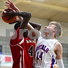 Kyle Bursaw – kbursaw@shawmedia.com<br /> <br /> Mooseheart's Akim Nyang grabs a rebound over Hinckley-Big Rock's Michael Bayler in the first quarter. Hinckley-Big Rock defeated Mooseheart 58-51 at Hinckley-Big Rock High School on Wednesday, Dec. 5, 2012.
