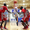 Kyle Bursaw – kbursaw@shawmedia.com<br /> <br /> Hinckley-Big Rock's Michael Bayler puts up a shot between Mooseheart players including Akim Nyang (44) in the first quarter. Hinckley-Big Rock defeated Mooseheart 58-51 at Hinckley-Big Rock High School on Wednesday, Dec. 5, 2012.