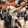 Rob Winner – rwinner@shawmedia.com<br /> <br /> Kaneland's Drew David (4) fouls DeKalb's Rudy Lopez during the fourth quarter in DeKalb, Ill., Friday, Dec. 14, 2012. Kaneland defeated DeKalb, 50-45.