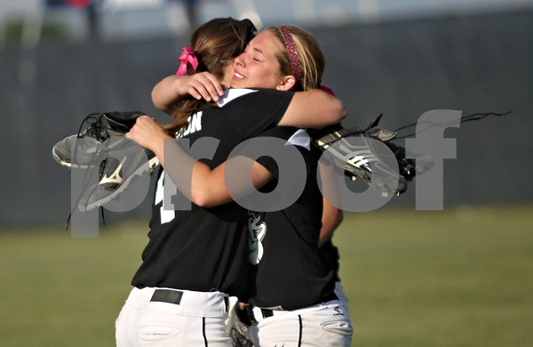 Rob Winner – rwinner@shawmedia.com<br /> <br /> Kaneland's Allyson O'Herron (left) hugs Delani Vest after Sterling defeated the Lady Knights, 9-1, during their Class 3A Belvidere North Sectional semifinal Wednesday, May 30, 2012. Sterling defeated Kaneland, 9-1.