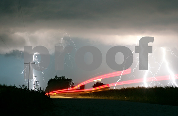 Rob Winner – rwinner@shawmedia.com<br /> <br /> Brake lights from a pickup truck heading westbound on Owens Road near the intersection of Somonauk and Owens Roads in Pierce Township can be seen as lightning strikes during a storm on Wednesday, July 18, 2012.